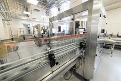 Automatic labeling machine during operation. Factory for the production of alcoholic beverages Stock Photo