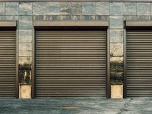 Automatic lift gates to garage car parking in new modern building. Close up royalty free stock image