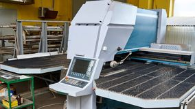 Automatic machine for cutting metal sheet in the workshop stock images