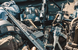 Automatic machine, machine gun, helmet, body armor piled in a heap Stock Image