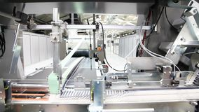Automatic machine working in printing house fold cardboard boxes stock footage