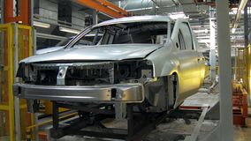 Automatic machines are transporting car bodies for construction and painting between departments