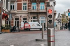 Automatic metallic bollard with red light royalty free stock photos