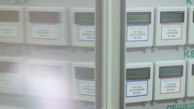 Automatic Meters in Apartment House Through Glass stock video footage