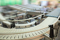 Automatic packing conveyor Stock Images