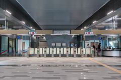Automatic payment gate at the MRT Mass Rapid Transit station. MRT is the latest public transportation system in Klang Valley fro. Kuala Lumpur,Malaysia - July 25 Royalty Free Stock Image