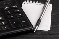 Automatic pencil, calculator and notepad Stock Image