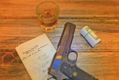 Automatic pistol with antique document and whiskey. Stock Image