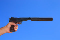 Automatic pistol in a hand Royalty Free Stock Photos