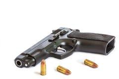 Automatic pistol handgun weapon with bullets Stock Photos