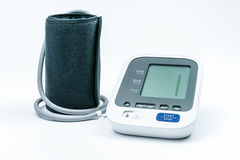 Automatic portable blood pressure machine with arm cuff on white, studio shot. Empty display without numbers stock image