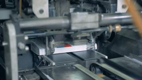 Automatic production, books on a typographical line. 4K stock footage