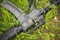 Automatic rifle in the grass Royalty Free Stock Images