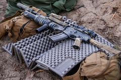 Automatic rifle with a grenade launcher. Automatic rifle with grenade launcher, among the things on ground stock photography