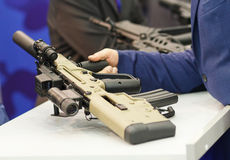 Automatic rifle in his hand. Exhibition and sale of weapons Royalty Free Stock Photo
