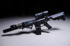 Automatic rifle with silencer and optical scope. Assult automatic rifle with silencer,optical scope and tactical flashlight stock photography