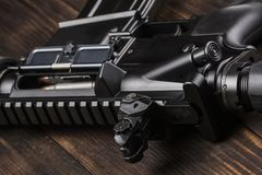 Automatic rifle on the table stock images
