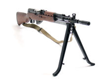 Automatic rifle on tripod. Soviet SKS automatic assault rifle with tripod, isolated on white background Royalty Free Stock Images