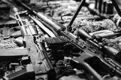 Automatic rifle. War guns arsenal. Modern military assault rifles shotgun weapon arms outdoors on natural background stock images