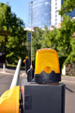 Automatic road barrier with flashing yellow light Stock Photos