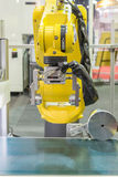 Automatic robot arm with optical sensor working in factory Stock Photography