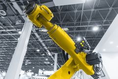 Automatic robot arm working in industrial environment stock photography
