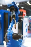 Automatic robot arm working in industrial environment royalty free stock photos
