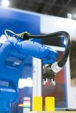 Automatic robot arm working in industrial environment stock image