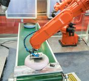 Automatic robot in assembly line working in factory. Smart factory industry 4.0 concept stock image
