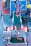 Automatic robot in assembly line working in factory Stock Photo