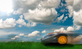Automatic robot lawn mower. Against dramatic sky royalty free stock image