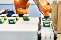 Automatic robot manipulator in factory. Automatic robot manipulator in food factory royalty free stock images