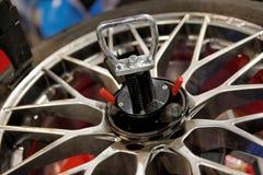 Automatic robot repairing wheel closeup Stock Photo