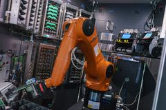 Automatic robotic arm, device inside the control system. automatic system for banking and cash operations. stock photos