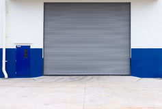 Automatic roller shutter door of storage warehouse royalty free stock image