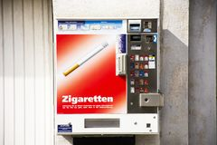 Automatic sale cigarette box on the wall at Sandhausen village in Heidelberg, Germany royalty free stock photo