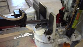 Automatic saw to saw a metal pipe. Automatic Band Saw. Slow motion stock video footage