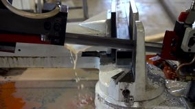 Automatic saw to saw a metal pipe. Automatic Band Saw. Slow motion stock footage