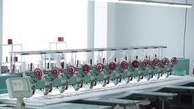The automatic sewing machine and item of clothing, Detail of sewing machine and sewing accessories stock footage