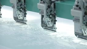 An automatic sewing machine needle in close up stock video footage