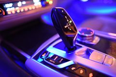 Automatic shift gear in a car. Interior and automatic gear inside a car, and other controls for setting driving modes stock photos