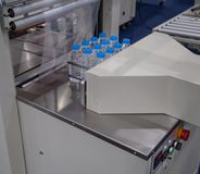 Free Automatic Shrink Wrapping Machine Royalty Free Stock Image - 140661456