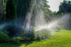 Automatic sprinkler system watering landscaping and garden