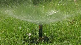 The Automatic Sprinkler When Watering The Lawn