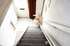 Free Automatic Stair Lift On Staircase Taking Elderly People And Disabled Persons Up And Down In A House Royalty Free Stock Photo - 162952615