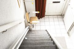 Free Automatic Stair Lift On Staircase Taking Elderly People And Disabled Persons Up And Down In A House Stock Image - 162952651