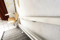 Free Automatic Stair Lift On Staircase Taking Elderly People And Disabled Persons Up And Down In A House Royalty Free Stock Photos - 162953718
