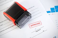 Automatic stamp on the contract document. Approved agreement Stock Photography