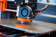 Automatic three dimensional 3d printer performs product creation. Modern 3D printing or additive manufacturing and robotic stock image