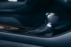 Selector automatic transmission with perforated leather in the interior of a modern expensive car. The background is blurred royalty free stock image